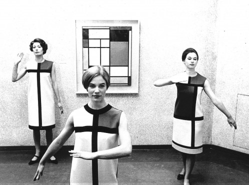 Three colleagues of the former Dutch Costume Museum dressed in Yves Saint Laurent dresses, fall 1965, in the Kunstmuseum Den Haag, 1966