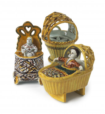 Three miniature models of a cradle, a high chair and a drying basket, Delft, 1750-1770, tin-glazed earthenware, height 13.5 cm, Kunstmuseum Den Haag – The Lavino Collection